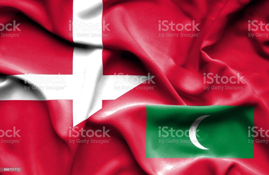 Waving flag of Maldives and Denmark stock photo