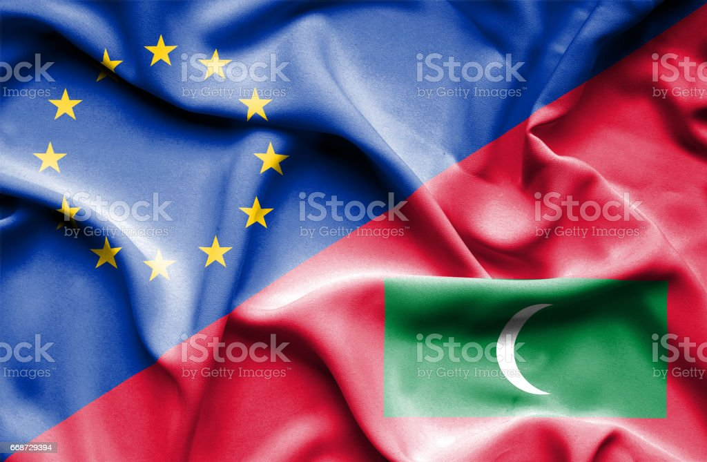Waving flag of Maldives and EU stock photo