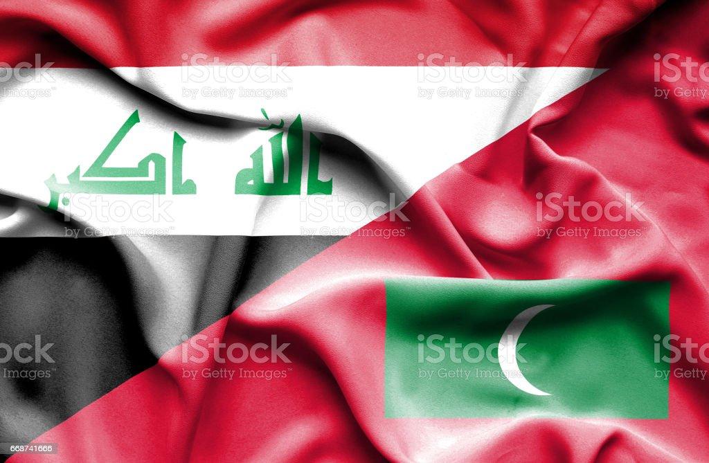 Waving flag of Maldives and Iraq stock photo