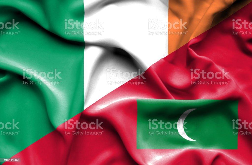 Waving flag of Maldives and Ireland stock photo