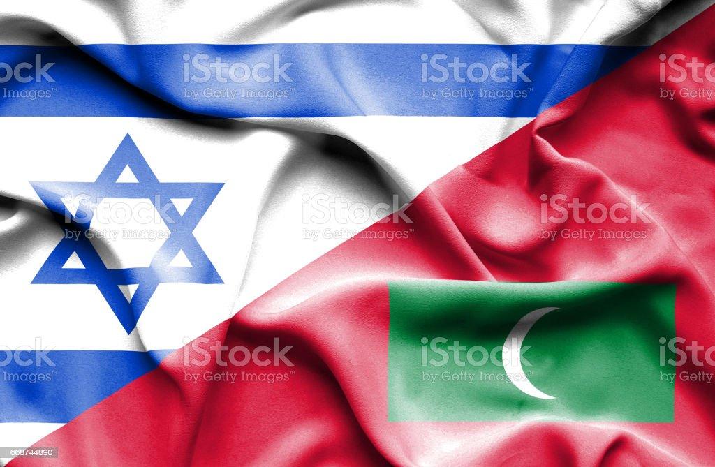 Waving flag of Maldives and Israel stock photo