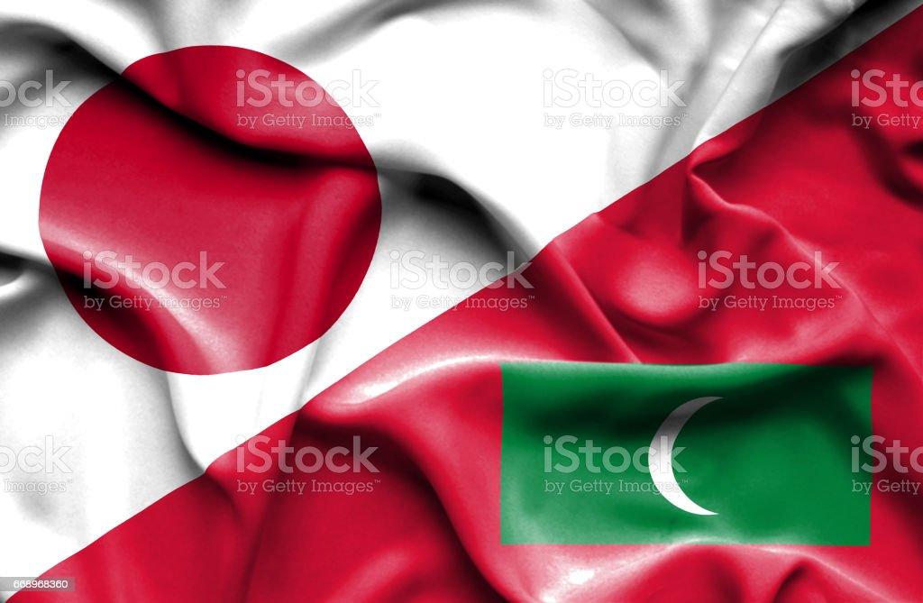 Waving flag of Maldives and Japan stock photo