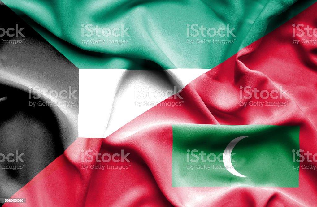 Waving flag of Maldives and Kuwait stock photo