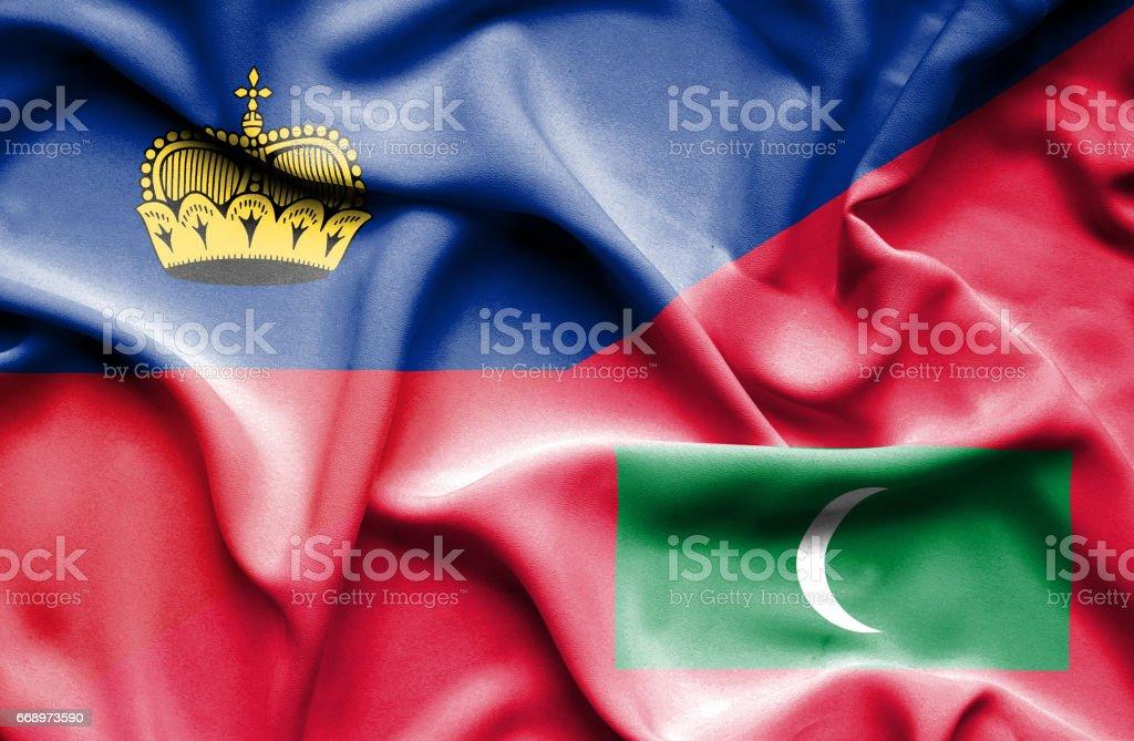 Waving flag of Maldives and Lichtenstein stock photo