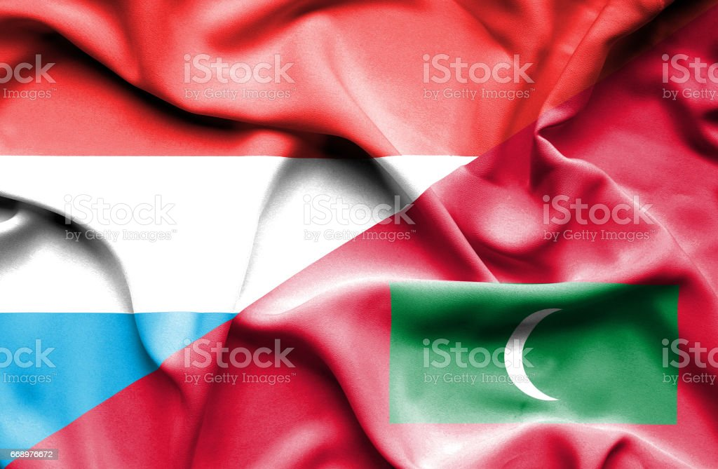 Waving flag of Maldives and Luxembourg stock photo