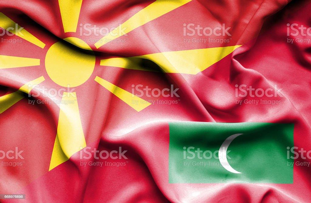 Waving flag of Maldives and Macedonia stock photo