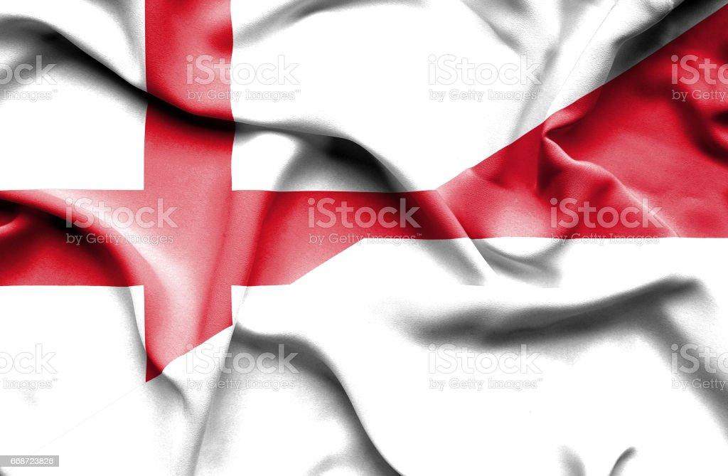 Waving flag of Monaco and England stock photo
