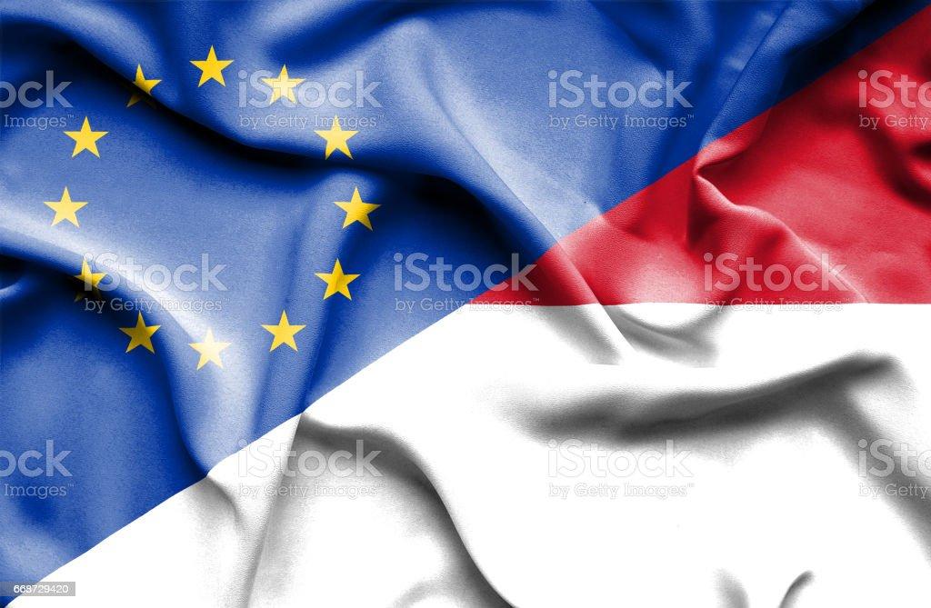 Waving flag of Monaco and EU stock photo