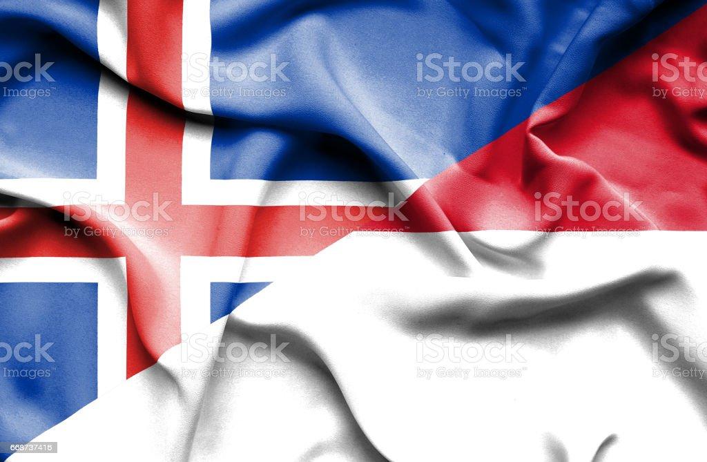 Waving flag of Monaco and Iceland stock photo