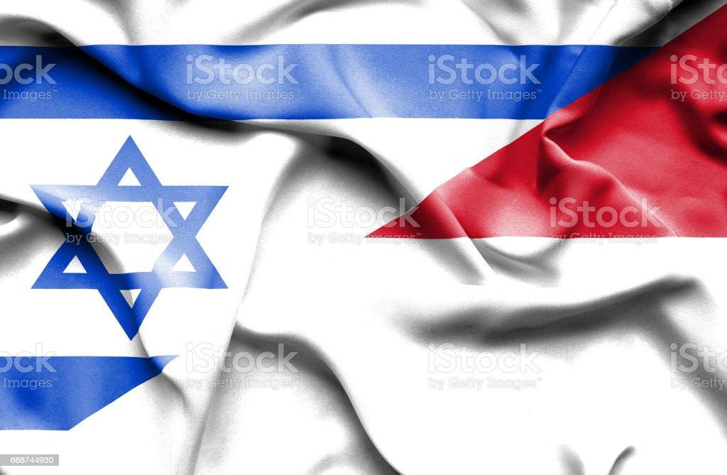 Waving flag of Monaco and Israel stock photo