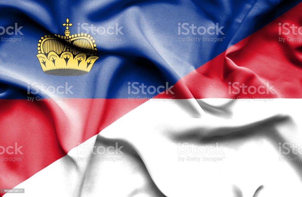 Waving flag of Monaco and Lichtenstein stock photo