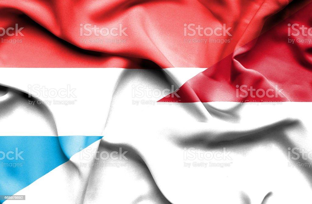 Waving flag of Monaco and Luxembourg stock photo