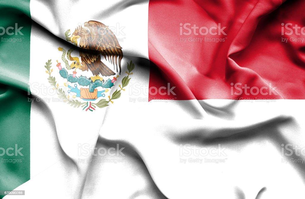Waving flag of Monaco and Mexico stock photo