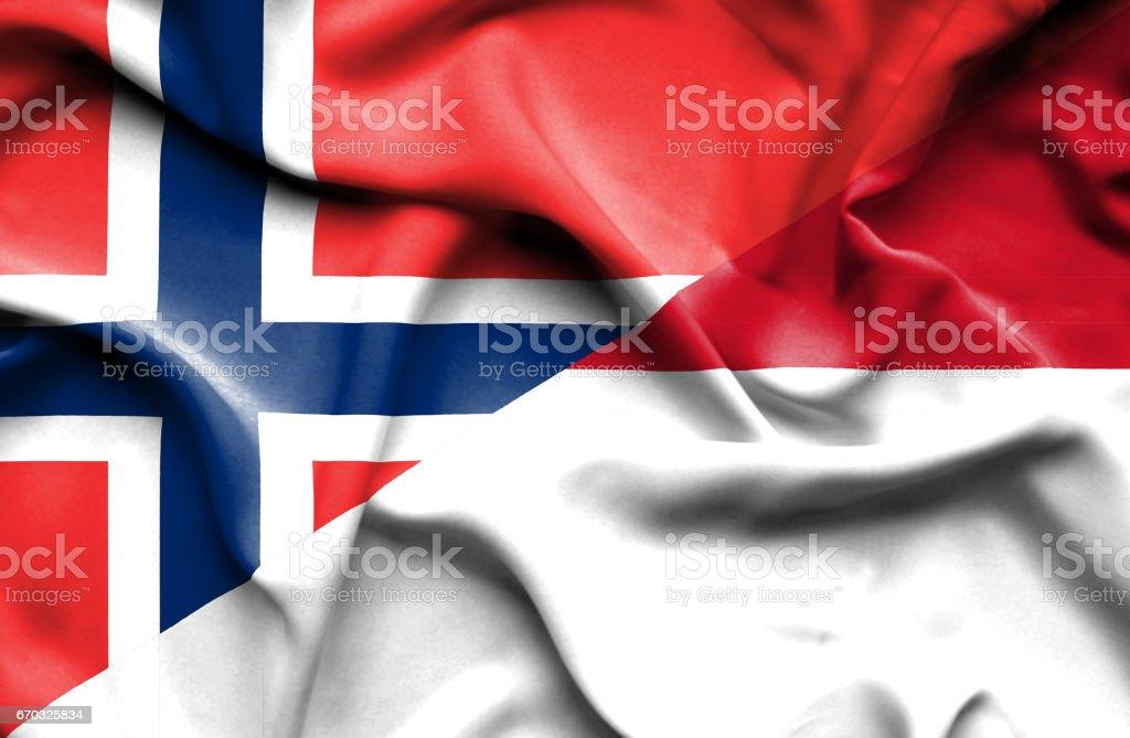 Waving flag of Monaco and Norway stock photo
