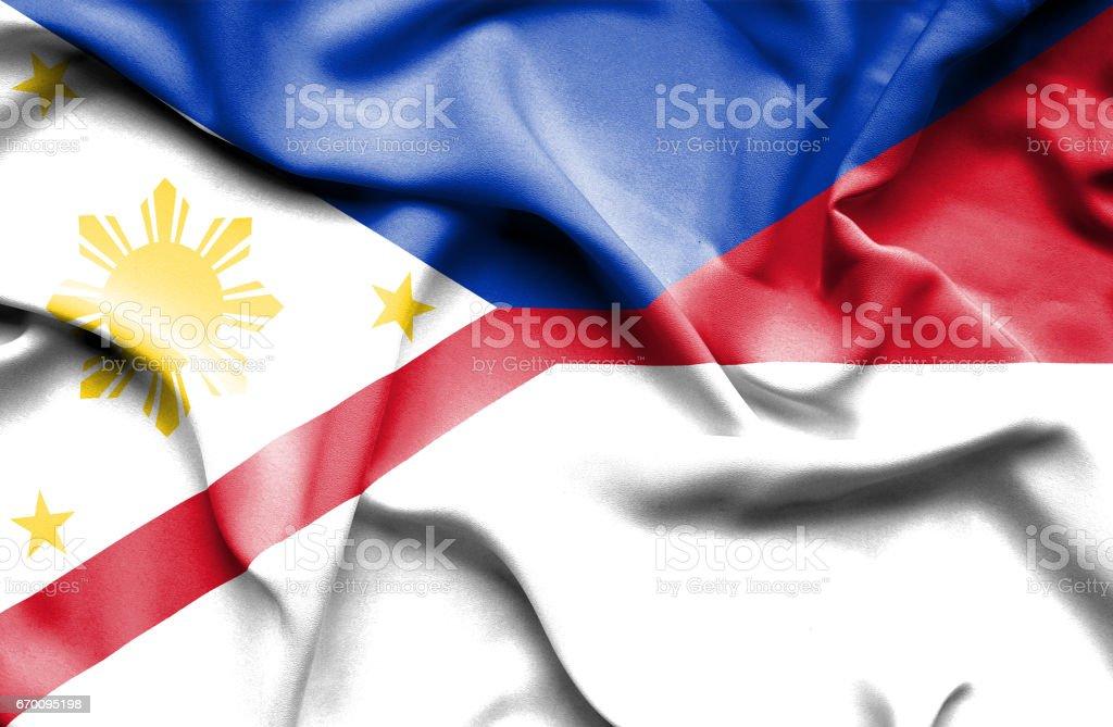 Waving flag of Monaco and Philippines stock photo