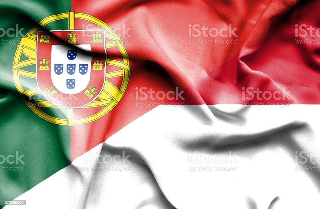 Waving flag of Monaco and Portugal stock photo