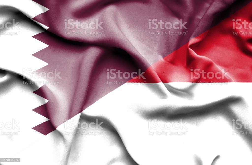 Waving flag of Monaco and Qatar stock photo