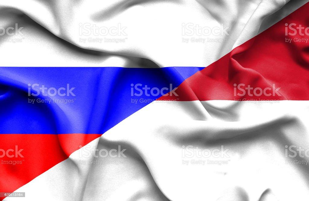 Waving flag of Monaco and Russia stock photo