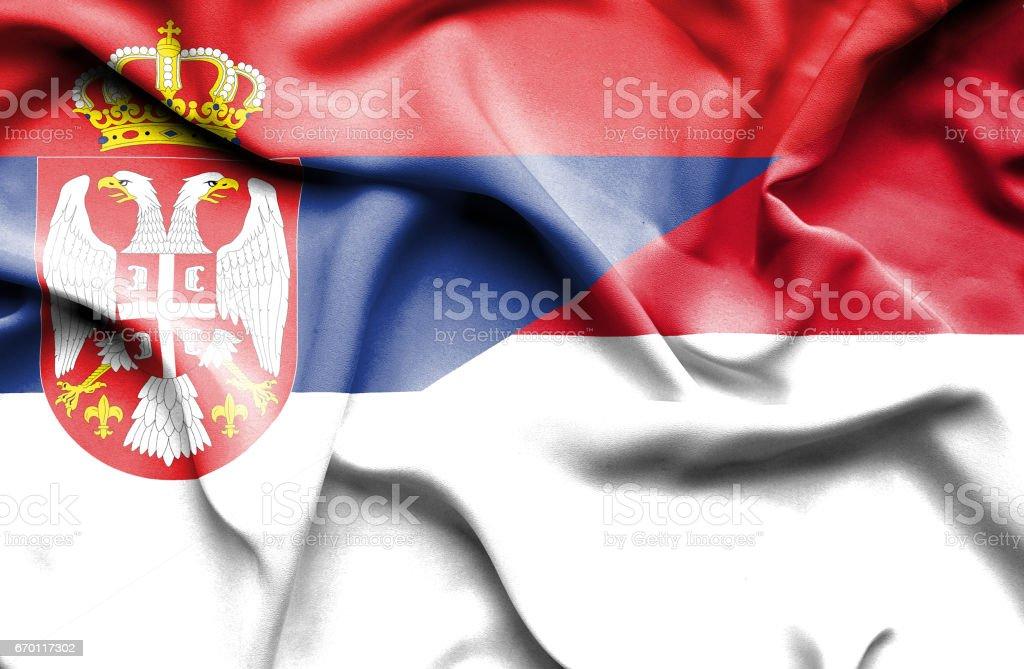 Waving flag of Monaco and Serbia stock photo