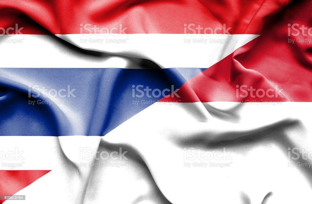 Waving flag of Monaco and Thailand stock photo
