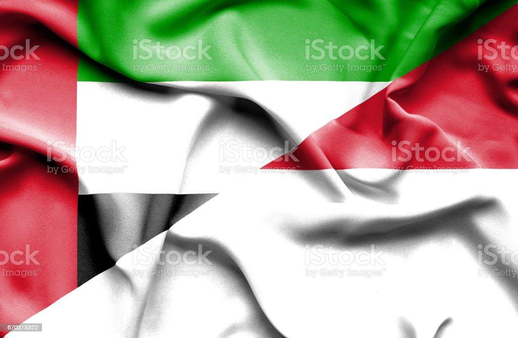 Waving flag of Monaco and United Arab Emirates stock photo