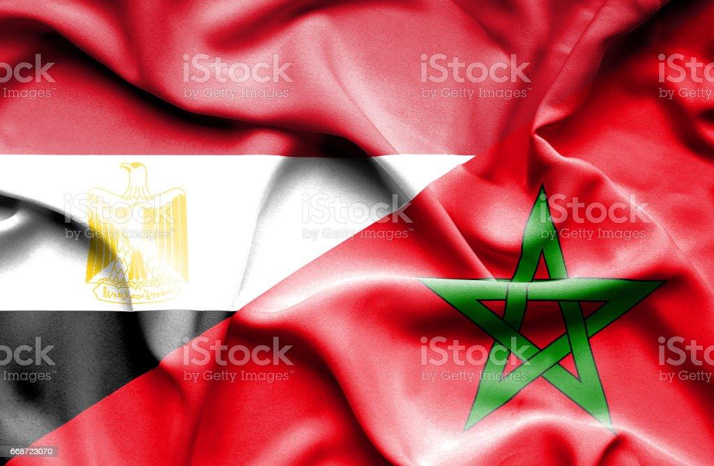 Waving flag of Morocco and Egypt stock photo