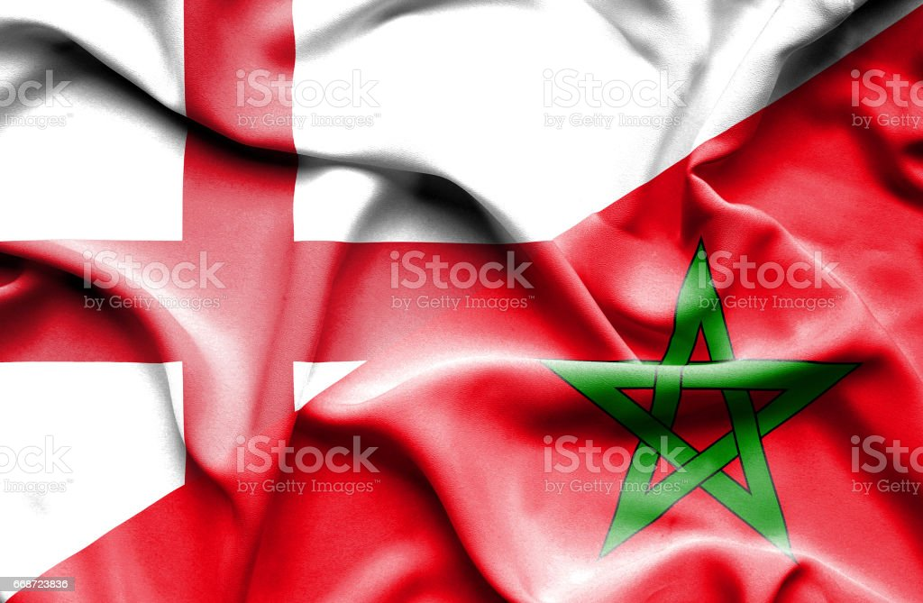 Waving flag of Morocco and England stock photo