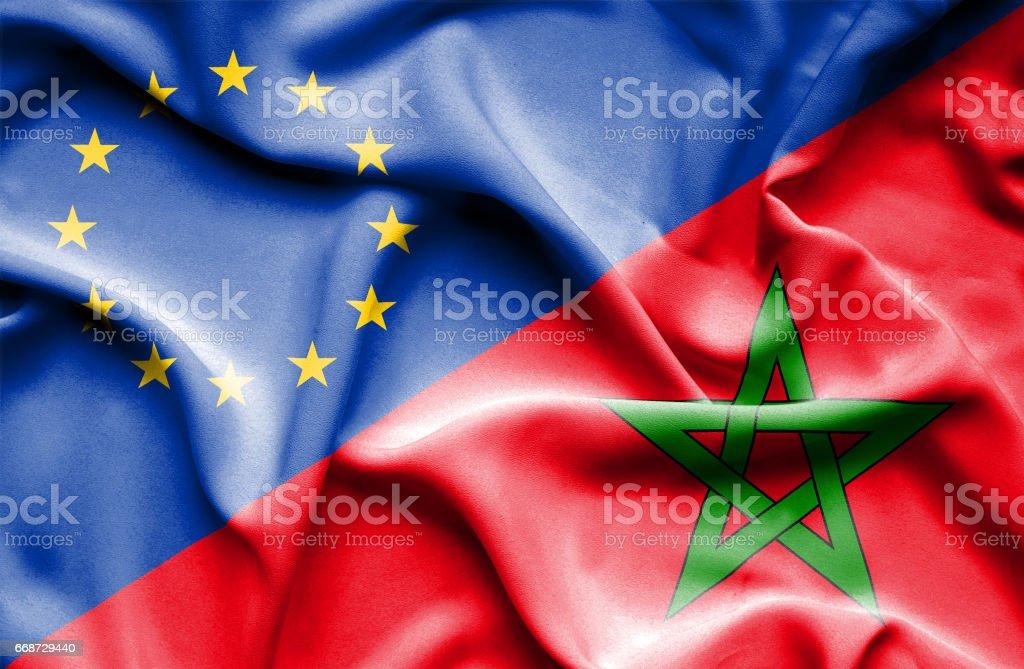 Waving flag of Morocco and EU stock photo