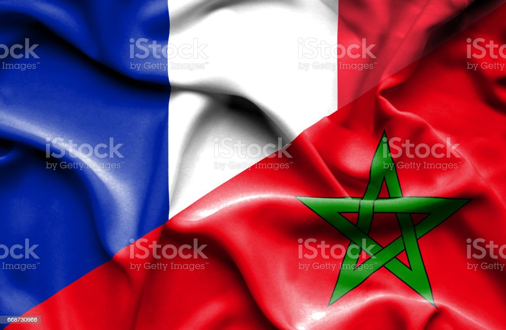 Waving flag of Morocco and France stock photo