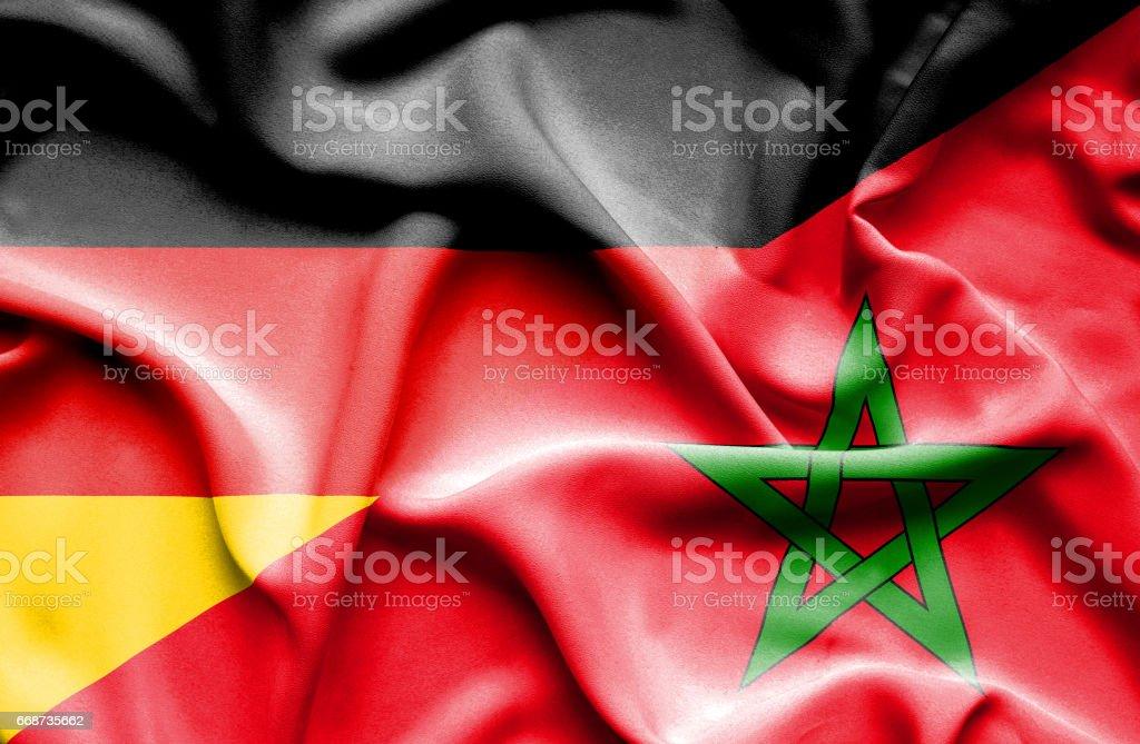 Waving flag of Morocco and Germany stock photo