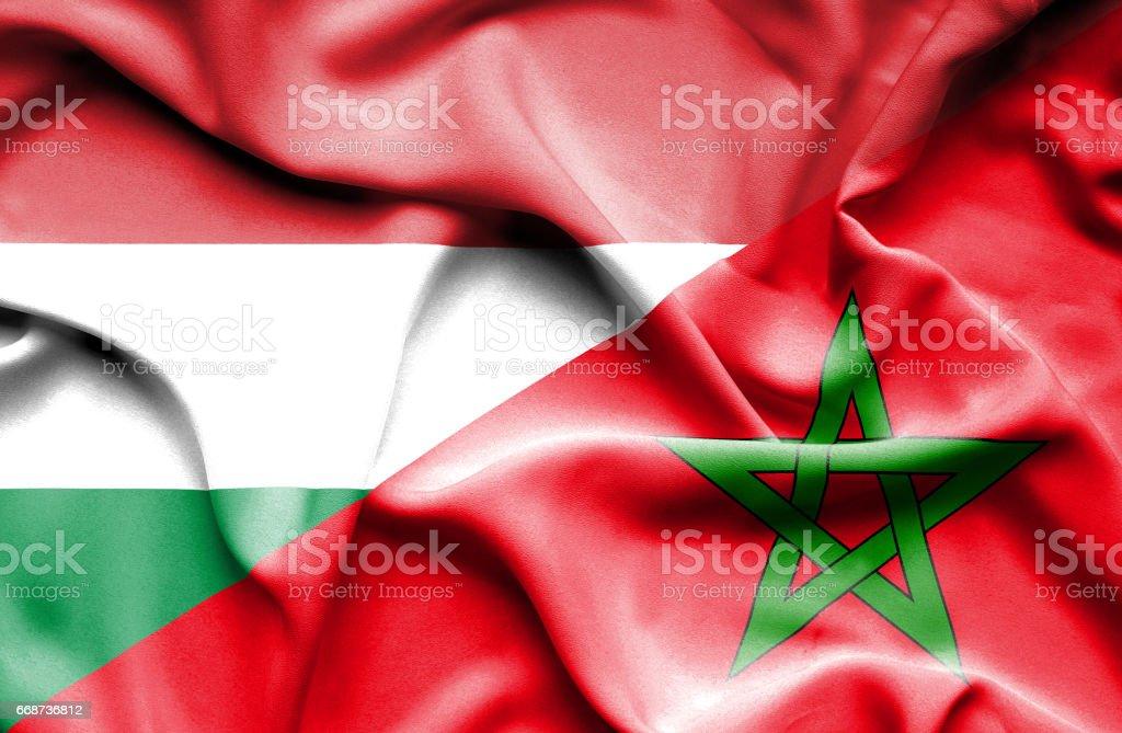 Waving flag of Morocco and Hungary stock photo