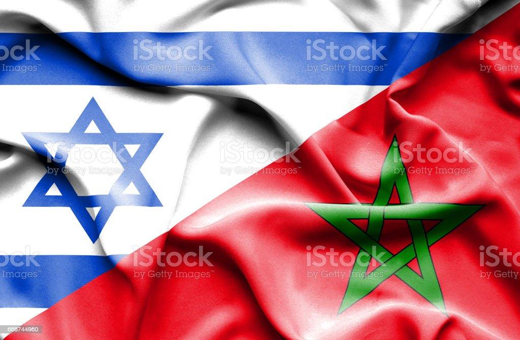 Waving flag of Morocco and Israel stock photo