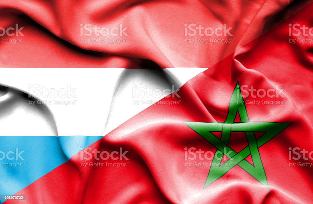 Waving flag of Morocco and Luxembourg stock photo
