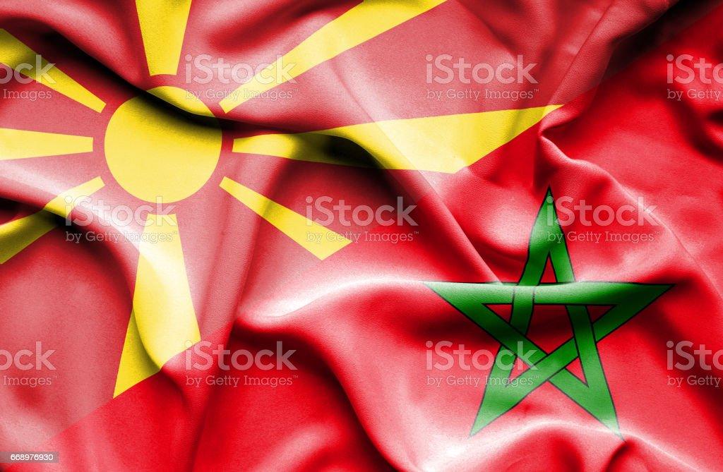 Waving flag of Morocco and Macedonia stock photo
