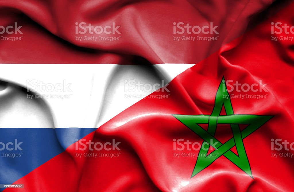 Waving flag of Morocco and Netherlands stock photo