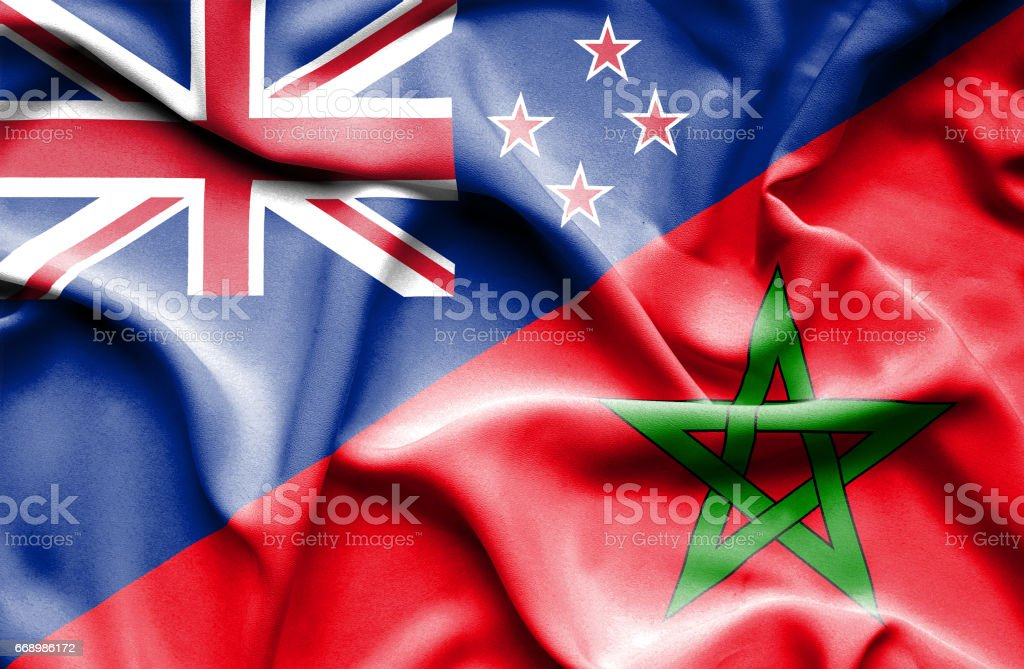 Waving flag of Morocco and New Zealand stock photo