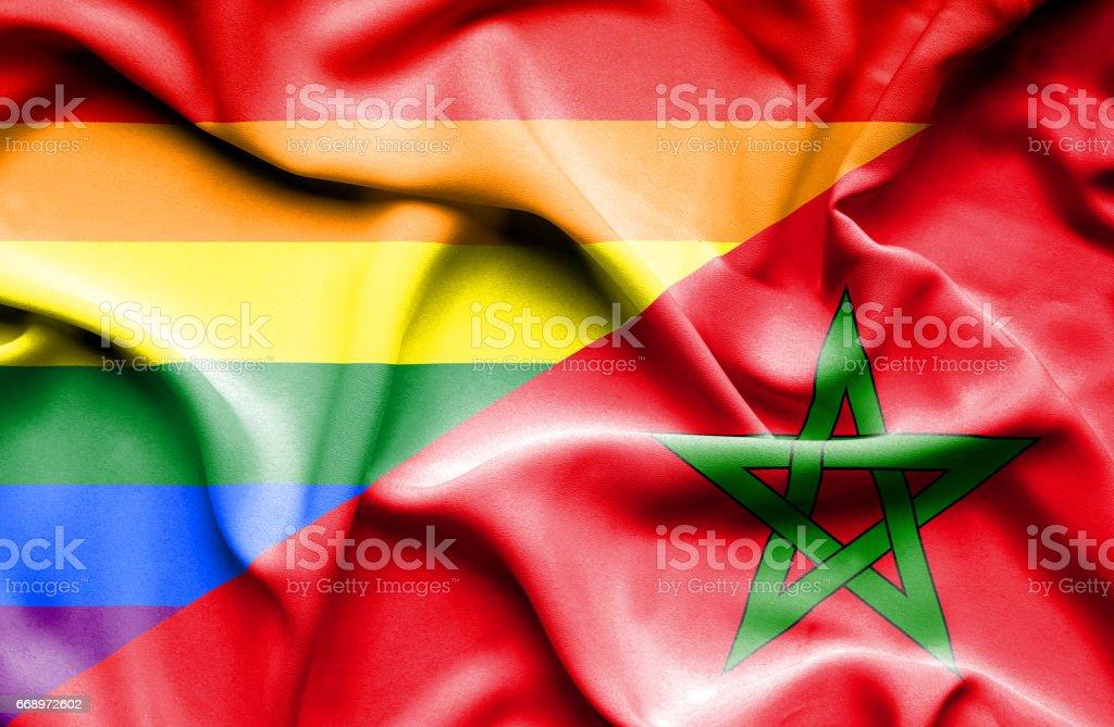 Waving flag of Morocco and Pride stock photo