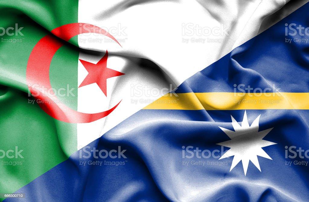 Waving flag of Nauru and Algeria stock photo