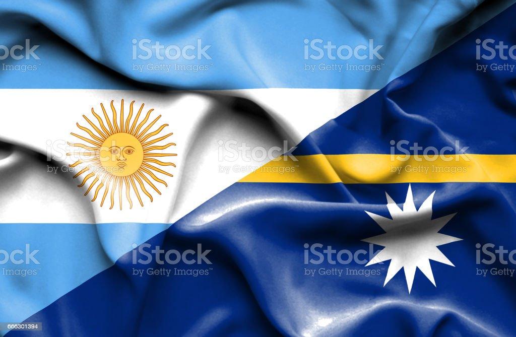 Waving flag of Nauru and Argentina stock photo
