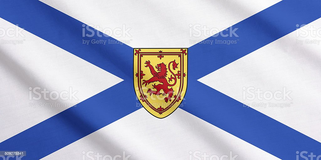Waving flag of Nova Scotia stock photo