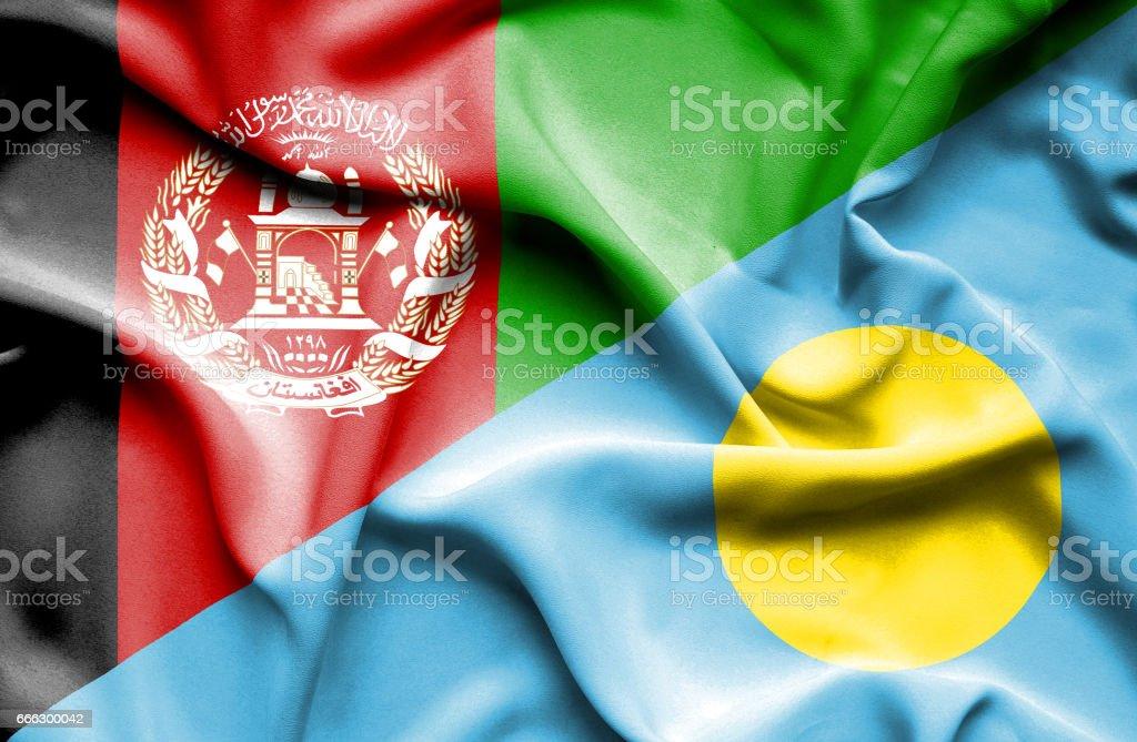 Waving flag of Palau and Afghanistan stock photo
