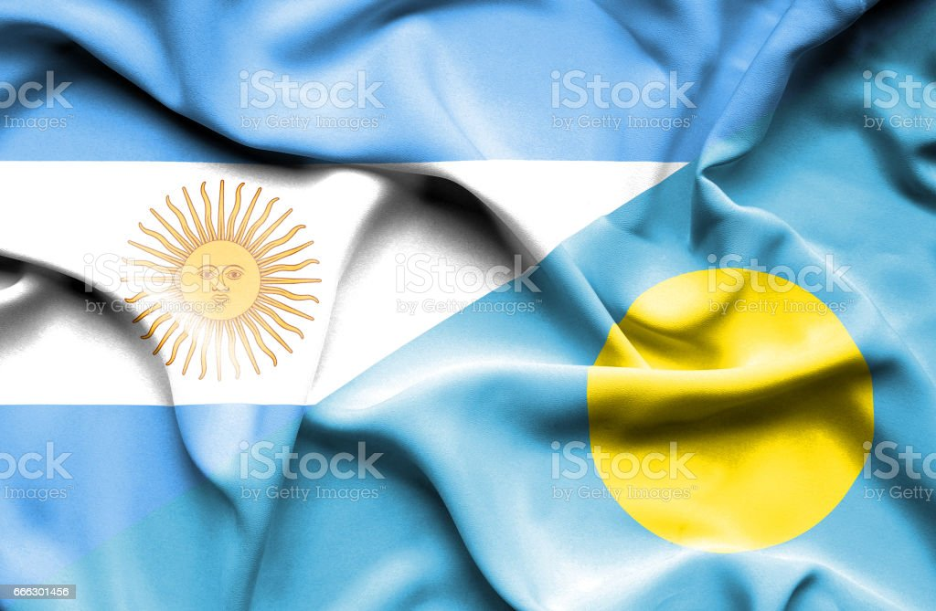 Waving flag of Palau and Argentina stock photo