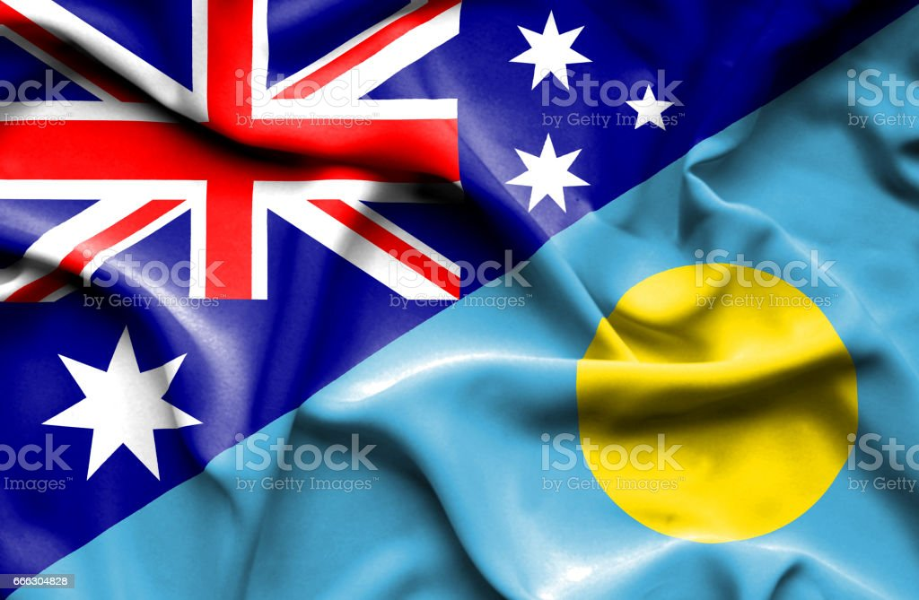 Waving flag of Palau and Australia stock photo