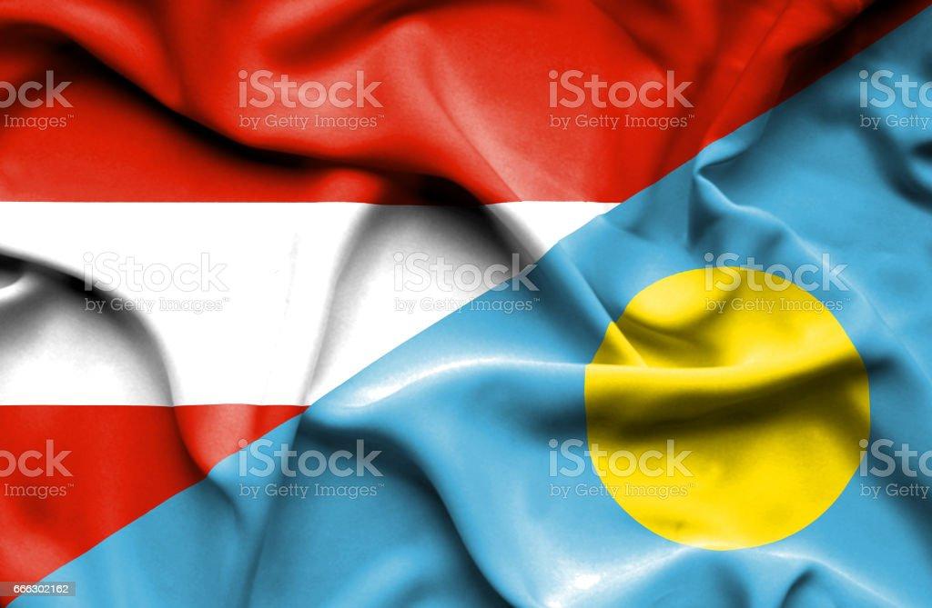 Waving flag of Palau and Austria stock photo