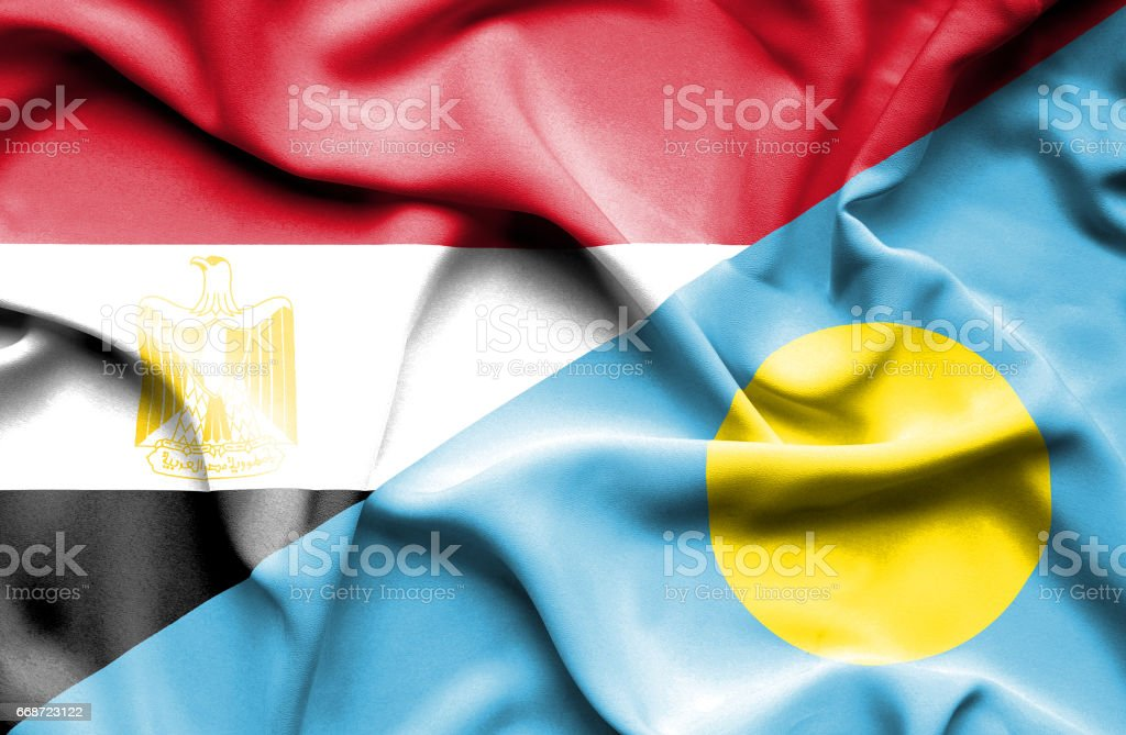 Waving flag of Palau and Egypt stock photo