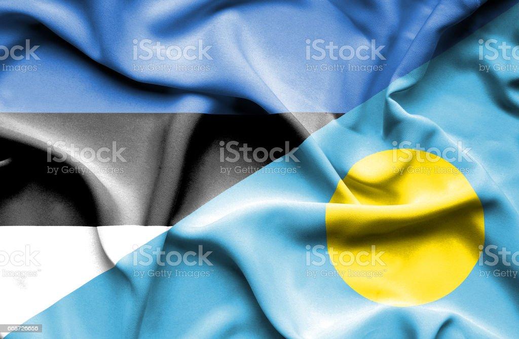 Waving flag of Palau and Estonia stock photo