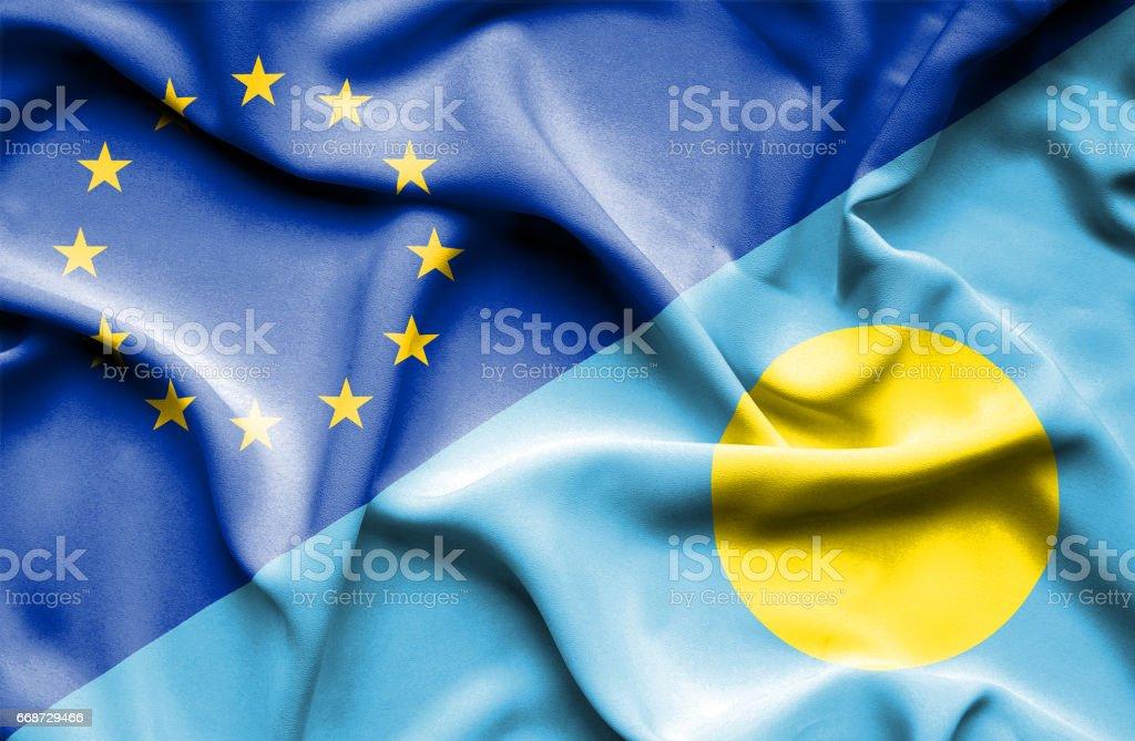 Waving flag of Palau and EU stock photo
