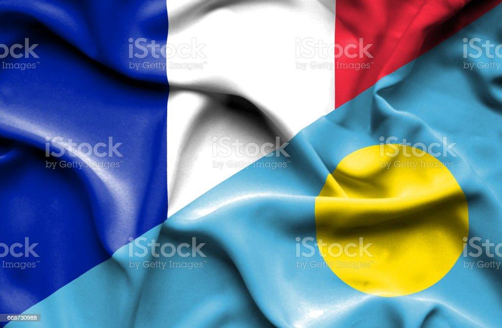 Waving flag of Palau and France stock photo