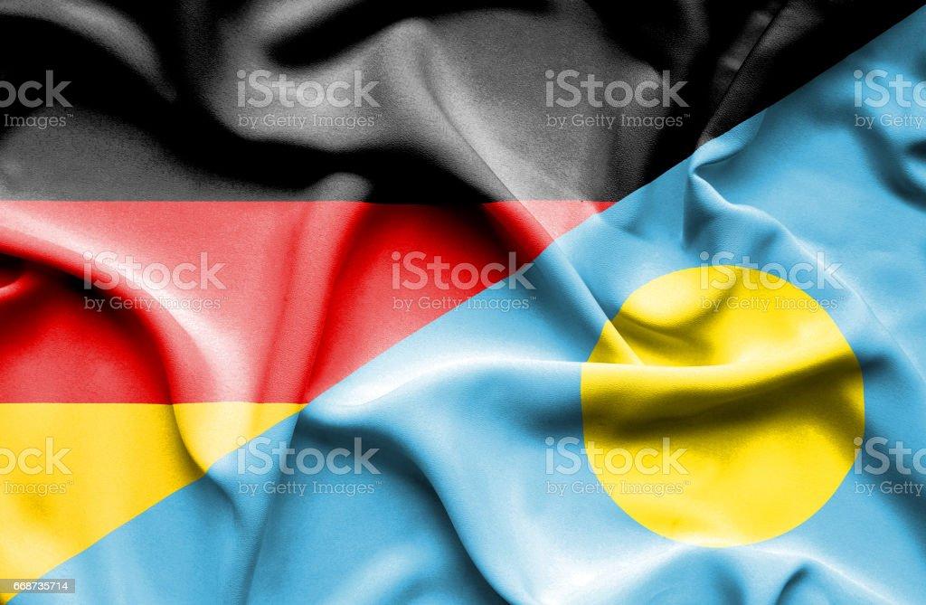 Waving flag of Palau and Germany stock photo