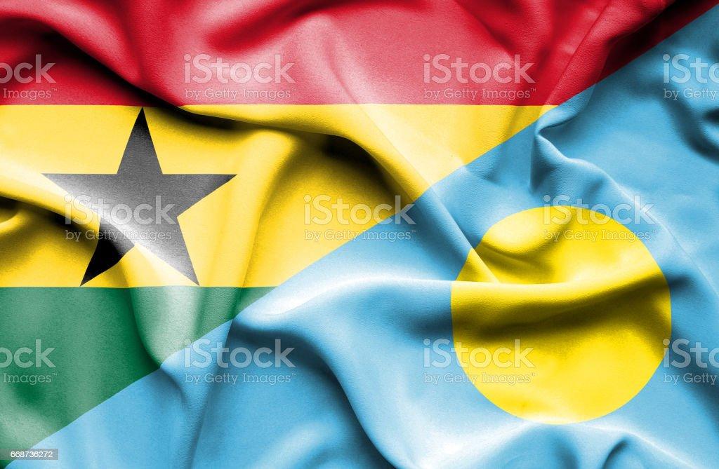 Waving flag of Palau and Ghana stock photo